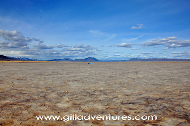Alvord Desert with  person supine at horizon