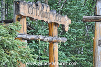 sign for one of the lodges on lake creek, alaska