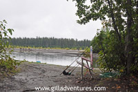 old chair and fishing rods on lake creek, alaska