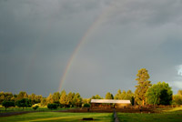 the stables at rock springs guest ranch and a rainbow