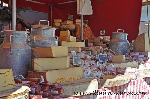 Fabulous regional Savoy cheeses and sausages on display at an open air booth in Meribel.