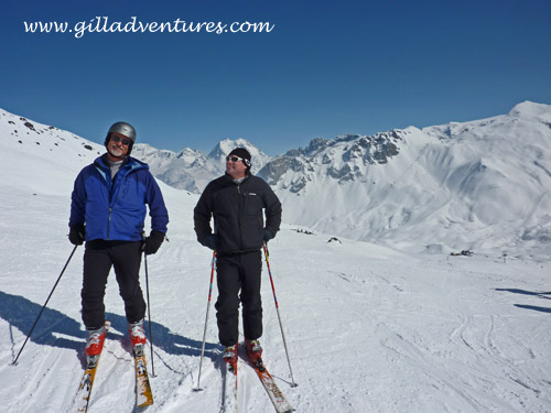 JB and Russell skiing on a bluebird day in Courchevel, France